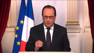 A screen shot of French President François Hollande during his annual New Year address from the Elysée Palace, December 31 2015