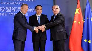 Chinese Premier Li Keqiang is welcomed by European Council President Donald Tusk and European Commission President Jean-Claude Juncker ahead of a EU China Summit in Brussels, Belgium, April 9, 2019.