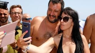 Italian Interior Minister and leader of the League party Matteo Salvini poses for a selfie as he meets supporters at the Caparena beach in the Sicilian seaside town of Taormina on August 11, 2019.