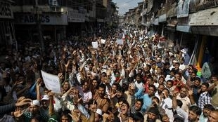 Kashmiri protesters take part in an anti-India protest  in Srinagar on Friday