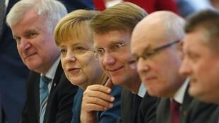 German Chancellor Angela Merkel with SPD leaders during coalition talks