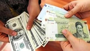 در هفته های گذشته ریال یک چهارم ارزش خود را در برابر دلار از دست داد