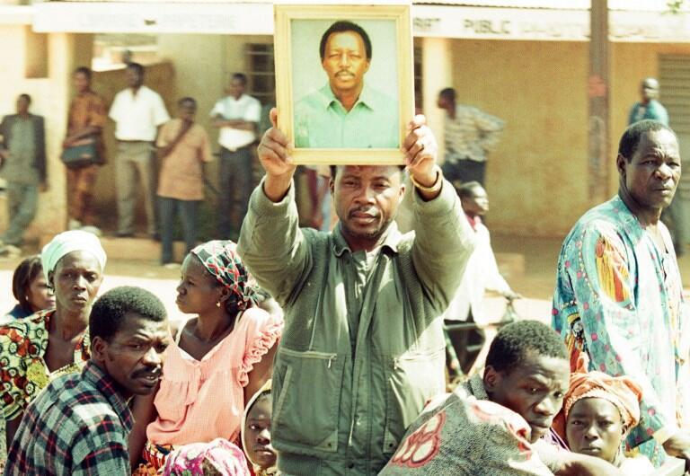 Supporters of murdered journalist Norbert Zongo holding his portrait in December 1998. Francois Compaore is facing charges related to his murder in Burkina Fasso.