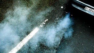 FILE PHOTO: A car produces smoke from its exhaust as it pulls away in Guernica October 29,2007.