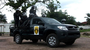 Riot police aboard a jeep in Limete, Kinshasa