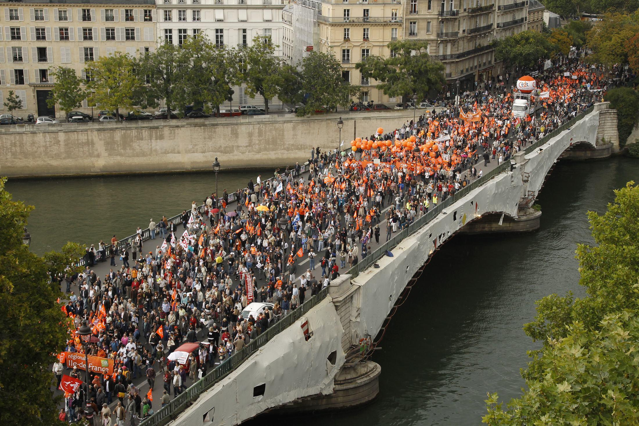Public and private sector workers march on the Pont de Sully bridge in Paris, 23 September 2010.