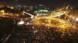 Le Caire, 31 décembre 2011. Coptes et musulmans se retrouvent sur la place Tahrir, d'où la révolte contre le régime de Hosni Moubarak a commencé, pour commémorer le souvenir de tous ceux qui ont été tués au cours de la répression.