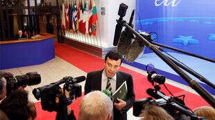 Irish Finance Minister Lenihan answers questions at the end of EU finance ministers meeting in Brussels