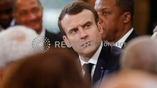 """French President Emmanuel Macron listens to a question during a meeting with mayors of oversee territories as part of the """"national debate"""" in Paris, France, February 1, 2019."""