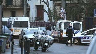 Police outside the block of flats in Toulouse on Wednesday