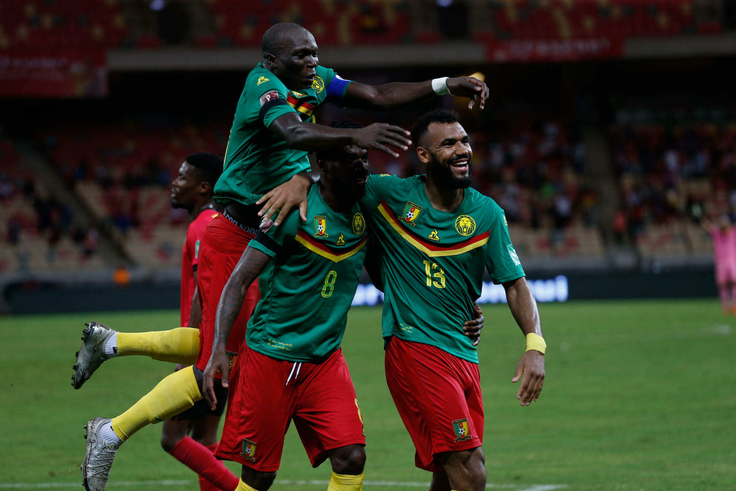 Eric Maxim Choupo-Moting (R) of Cameroon celebrates scoring against Mozambique in a World Cup qualifier in Douala on Friday.