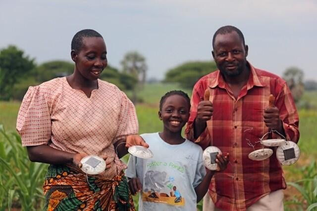 A family in the Chobe Enclave poses with their solar-powered strobe lights,