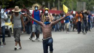Manifestation pour le départ du président haïtien Michel Martelly à Port-au-Prince, le 16 décembre 2014.