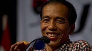 Joko Widodo, alias Jokowi, le 14 juin 2014, lors d'un meeting tenu à Solo, sa ville natale, dans l'est de l'île de Java.