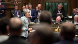 British Prime Minister Theresa May speaks in Parliament in London, Britain March 25, 2019.