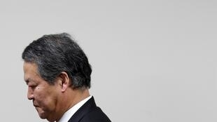 On his way out: Justice Minister Yanagida leaves a news conference at the ministry in Tok