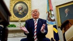 TT Mỹ Donald Trump trả lời báo giới tại Phòng Bầu Dục ở Nhà Trắng (Washington, Hoa Kỳ), ngày 20/08/2019.