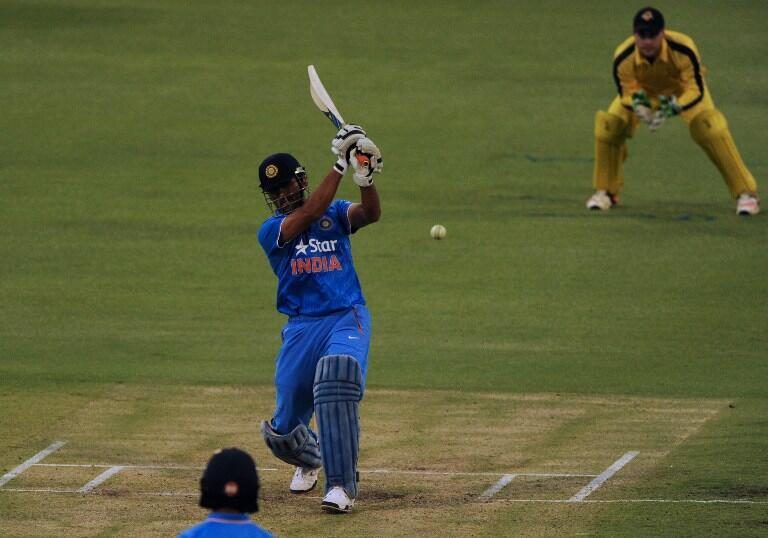 India's Mahendra Singh Dhoni plays a shot during the T20 cricket match between India and a Western Australian XI in Perth on 8 January.