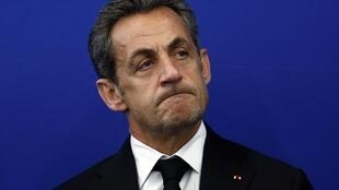 Former French President Nicolas Sarkozy attends the inauguration of the Institut Claude Pompidou, in this March 10, 2014 file photo.