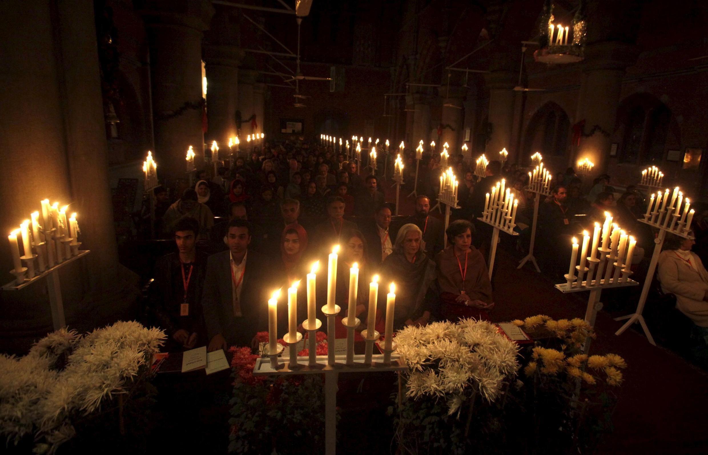 People attend a mass at a church in Lahore ahead of Christmas on 20 December, 2015.