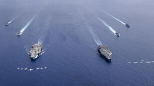 Aircraft carriers the USS Nimitz and USS Ronald Reagan sailing in Asia in July -- Washington is pushing back against Beijing over its military buildup in the South China Sea