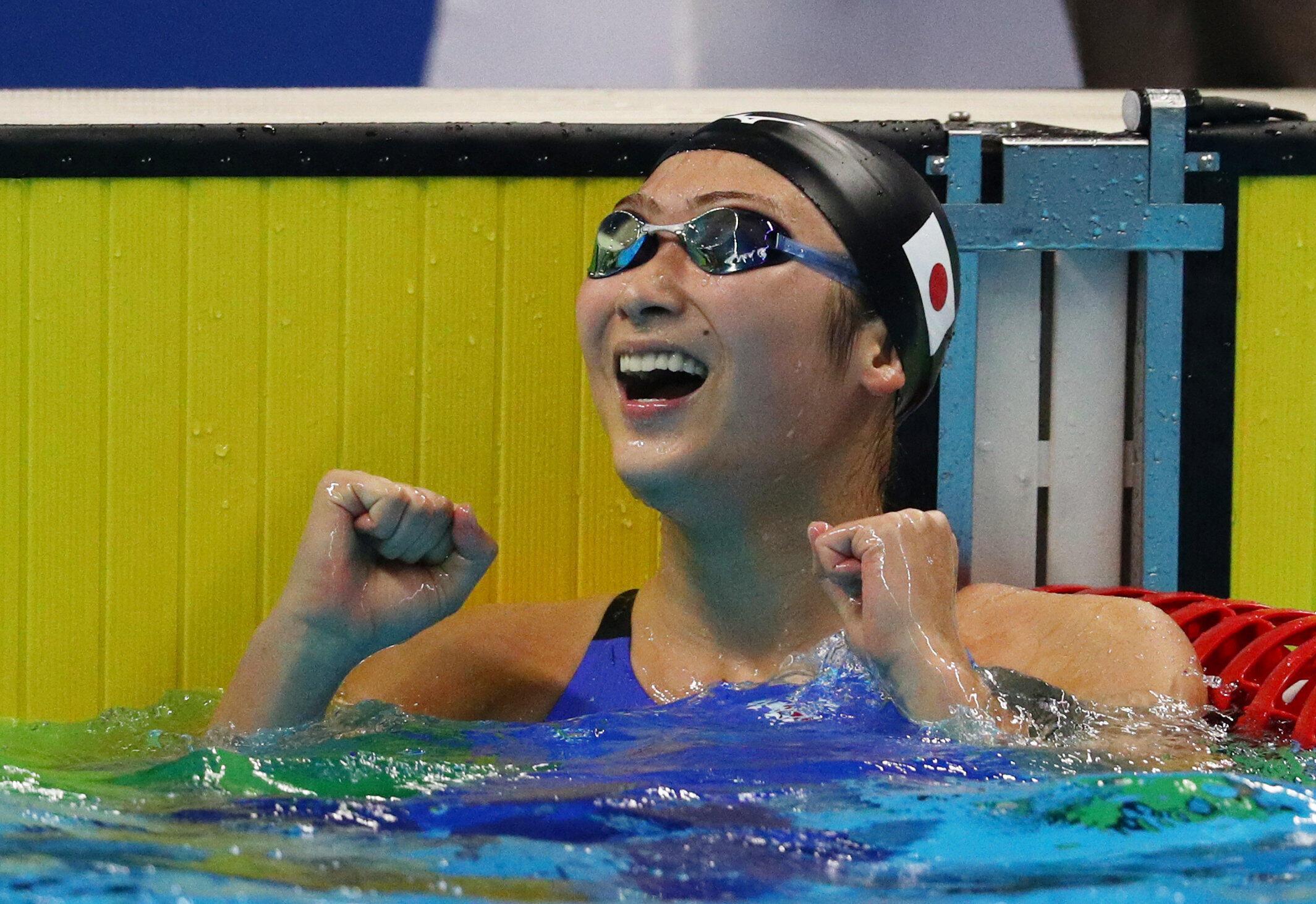 Rikako Ikee celebrates winning the Women's 50m Freestyle event.