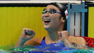 Rikako Ikee celebrates winning the Women's 50m Freestyle event.