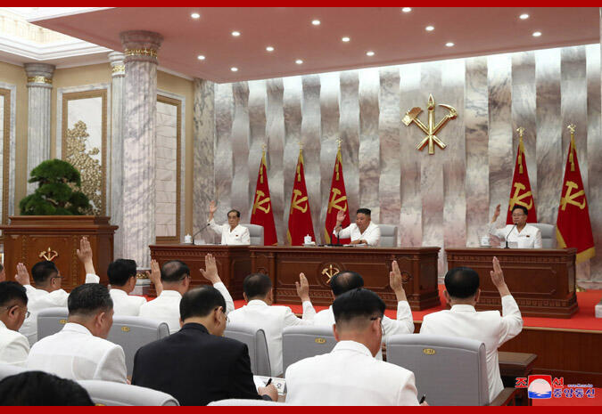 """Kim Jong-Un speaking at a session of the Politburo of North Korea's Worker's Party. He sharply criticised """"inattention, onlooking and chronic attitude"""" which are becoming """"prevalent among officials"""" who were violating """"rules of the emergency anti-epidemic work""""."""