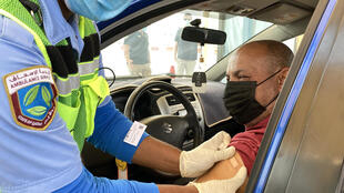 Qatar has set up drive-through centres to speed up its vaccination drive