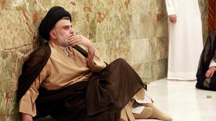 Iraqi Shia cleric Moqtada al-Sadr visits his father's grave in Najaf after the parliamentary election results were announced