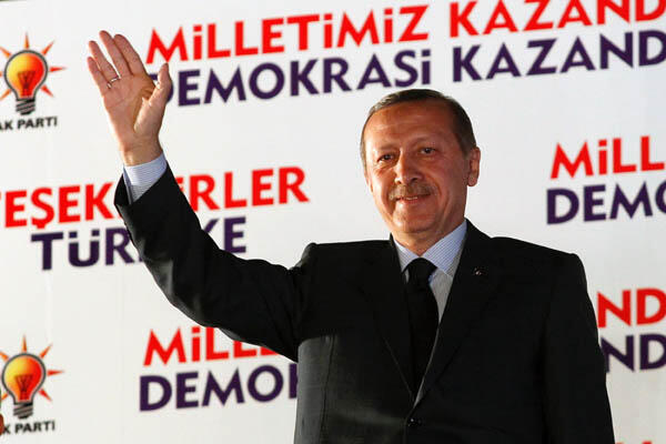 Recep Tayyip Erdogan acknowledges supporters' cheets
