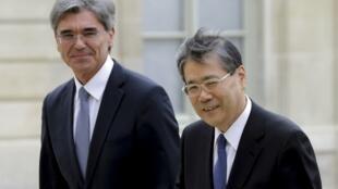 President of Siemens, Joe Kaeser and Head of Mitsubishi, Shunichi Miyanaga at the Elysee Palace in Paris, 17 June 2014.