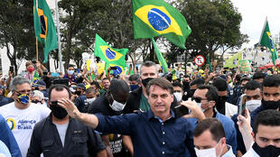 Brazilian President Jair Bolsonaro (pictured May 24, 2020) has touted the supposed benefits of hydroxychloroquine and a related drug, chloroquine, against the new coronavirus