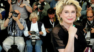 FILE PHOTO: French actress Catherine Deneuve smiles during a photo call at the 58th Cannes Film Festival May 12, 2005.