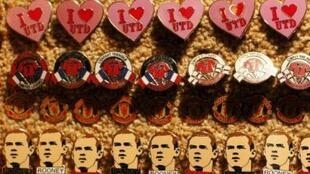 Badges depicting Wayne Rooney on a stall before their Champions League soccer match against Bursaspor at Old Trafford