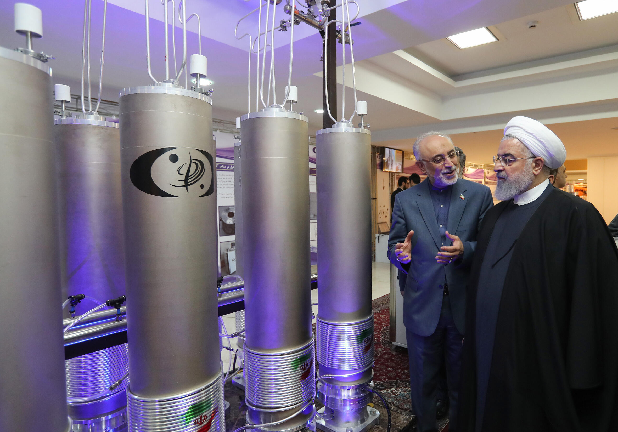 Iran's atomic agency chief Ali Akbar Salehi speaks to President Hassan Rouhani in this handout picture made available by the presidential office on April 9, 2019