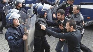 Riot police break up a previous protest in Algiers