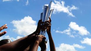 Children hold the Twenty20 World Cup trophy