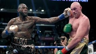 Lors du premier combat entre Deontay Wilder (à gauche) et Tyson Fury.