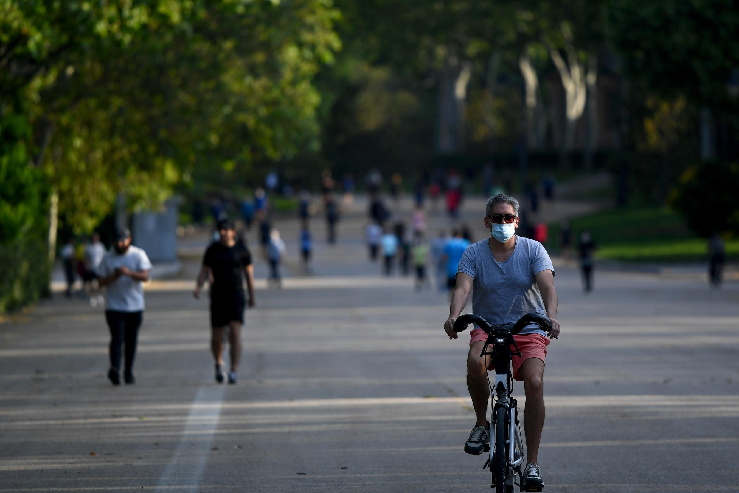 Hundreds of people packed parks in Madrid as Spain eased months-long lockdown measures