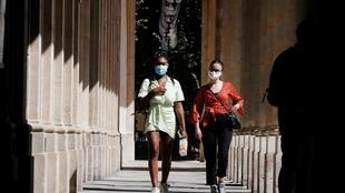 Pedestrians seen in the Paris where masks are compulsory in many areas of the city as of 3 August 2020.