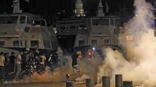 Police fire teargas at fans on the Marseille Old Port on Saturday night