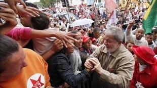 Brazil's President Lula is greeted by supporters during a campaign rally in Sao Bernardo do Campo