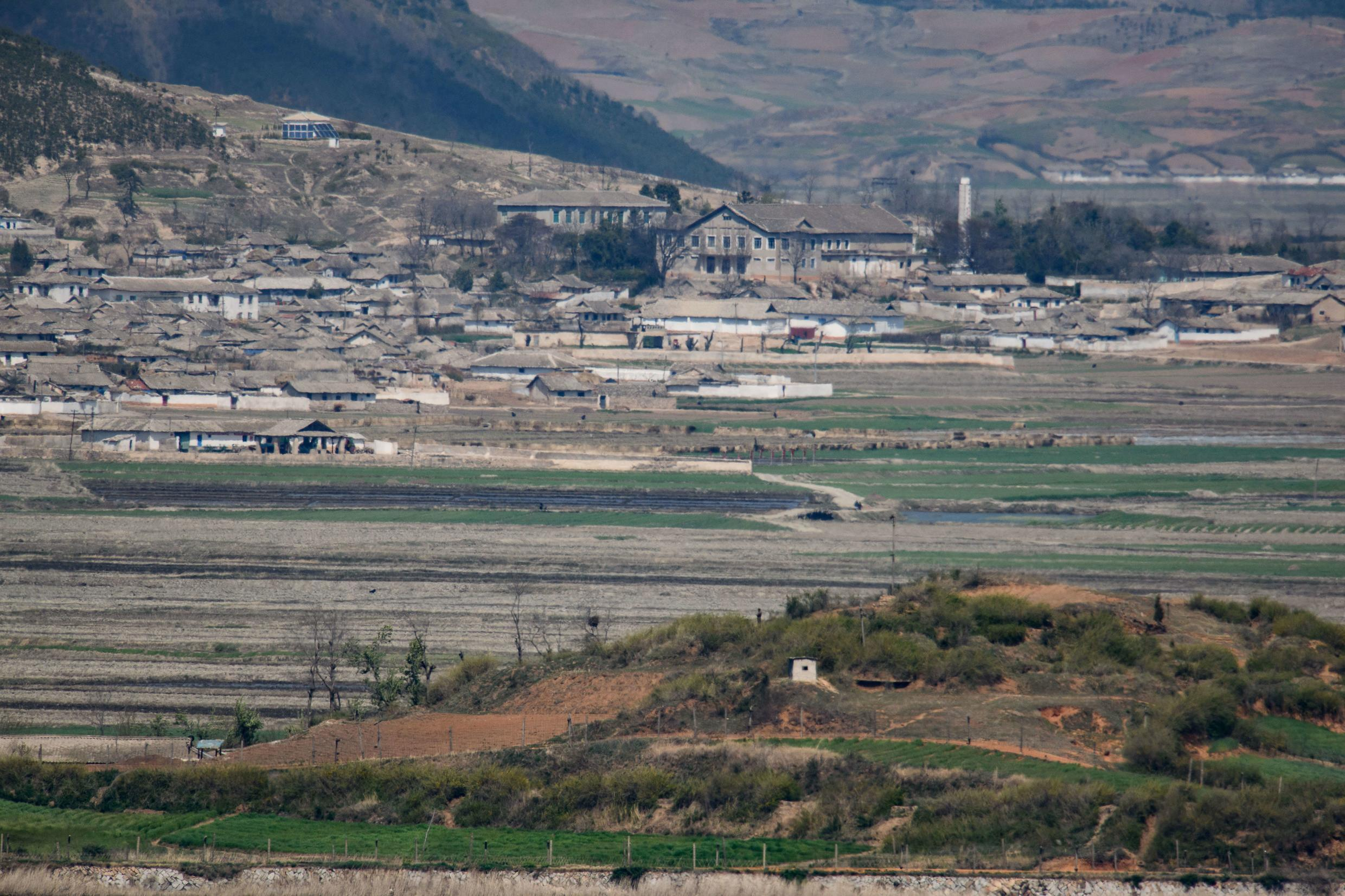 A general view of fields and buildings outside Kaesong in North Korea, seen across the Demilitarized Zone from the South Korean island of Ganghwa