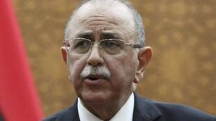 Libya's newly elected interim Prime Minister Abdurrahim el-Keib speaks during a news conference in Tripoli, 31 October 2011