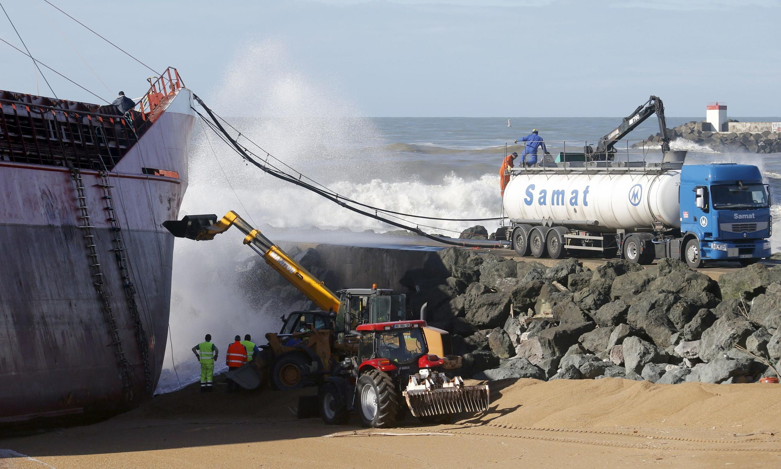 French firefighters and rescue workers at Spanish cargo ship Luno