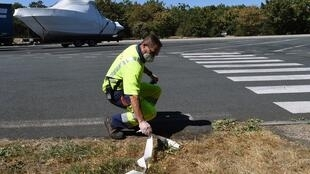 Olivier, Vinci highways patroller, cleans a rest area on the A11 highway between Angers and Nantes on the eve of the August holidays departure,