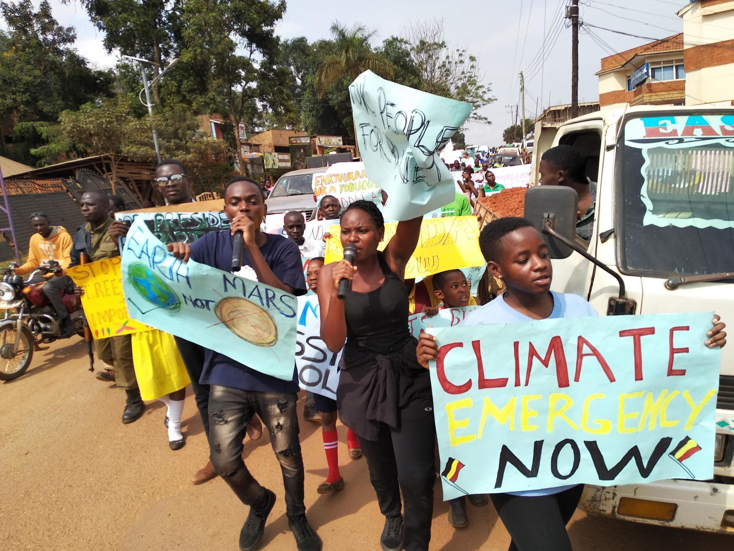 Hilda Flavia Nakabuye (in centre) demonstrates with other climate strikers from the Fridays for Future Uganda movement to call for climate action