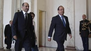 French President Francois Hollande (R) and  and SNC chief Ahmad Jarba (L) at the Elysée Palace