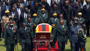 The body of Zimbabwe's founder and longtime ruler Robert Mugabe is brought to the national sports stadium for a state funeral in Harare, Zimbabwe, September 14, 2019.